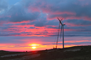 Just before midnight, a blade is attached to a wind turbine at the Eva Creek Wind Farm in Ferry, Alaska
