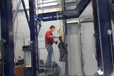 A Capital Safety technician tests a harness with weighted dummy body. The company maintains its own testing lab, rather than using an outside facility, in part so that tests are done in a timely manner.