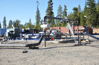 Stimulation pumps set up at the Newberry EGS demonstration site